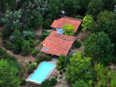 Photo for Forest house 220m2 wood, large pool, ocean 15min, calm
