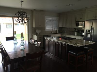 Kitchen and Dining.  All new cabinetry w/granite and appliances.  Table seats 6.