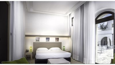 Photo for 1BR Hotel Suites Vacation Rental in Lizzano