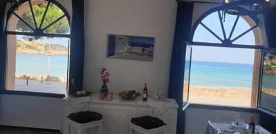 Photo for Apartment with garden at 11 meters from the sand beach of la Fosca.