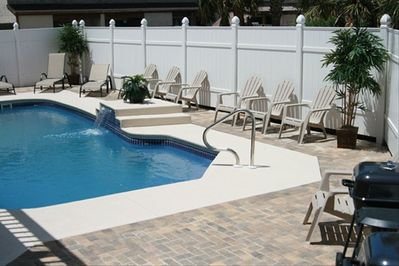 Private pool with 6 foot high privacy fence and charcoal grills