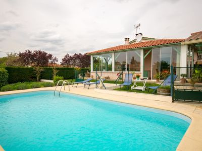 Photo for Cosy home in quiet bungalow district, large garden and private swimming pool.