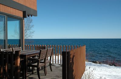 deck steps from the water for outdoor dining & visiting