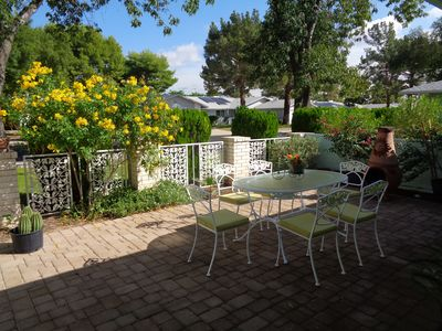 Photo for Beautiful Gated Front Patio And Private Greenbelt In back with Fruit Trees.