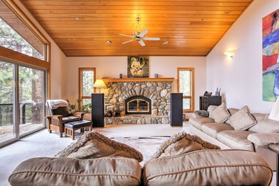 Relax on the plush furniture as you warm up by the wood-burning fireplace.