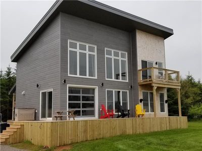Daytime photo enjoy the outdoors. Front and rear decks.