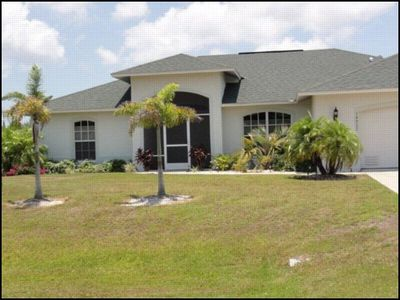 Photo for Sailboat Access in a three bedroom, two bathroom, plus den,salt water heated pool and spa home.