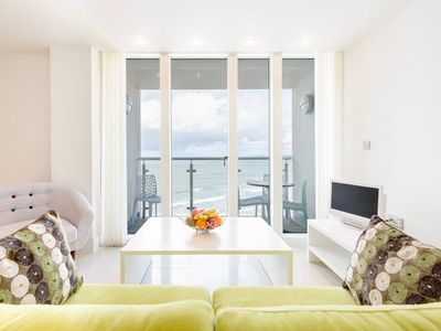 Photo for Stunning views over Tolcarne beach. Contemporary apartment with a private balcony.