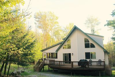 Nestled among the trees & situated on a double sized lot for your added privacy