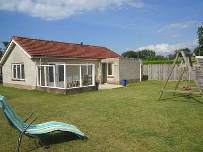 Photo for The bungalow is located in the small, quiet park Pinusoord (located next to the North Sea Park). The garden is completely fenced and private.