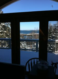 French doors, view of water and woods.