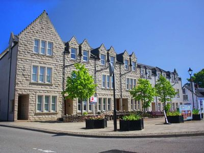 Photo for Modern luxury apartment overlooking the main square in Dornoch.