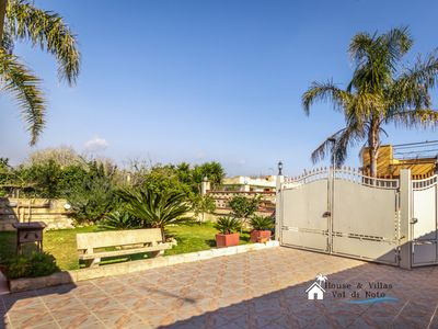 Photo for 100 meters from the sea, air conditioning, indoor parking, garden