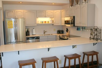 Well equipped modern kitchen with stainless steel appliances