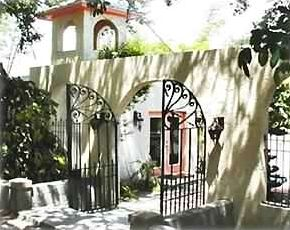 Enter the Spanish-style courtyard through the original wrought iron gates