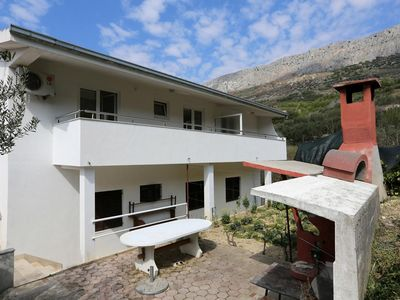 Photo for One bedroom apartment with balcony and sea view Sumpetar, Omiš (A-11798-b)