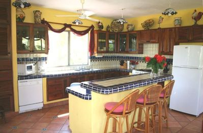Fully appointed kitchen is bright with Talavera tiles and pottery