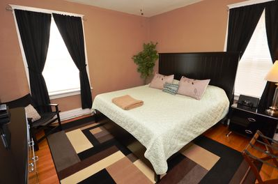 Bedroom with king sized bed, memory foam mattress and 19' TV