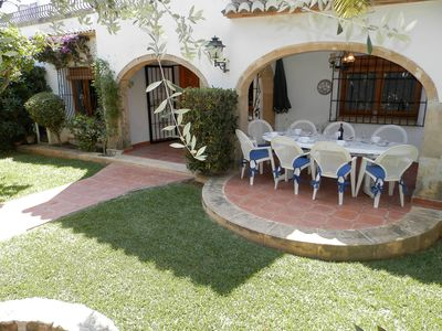 Private garden with dining and barbecue area
