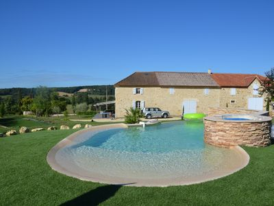"Photo for ""La Borde"" Gers farmhouse character with swimming pool, jacuzzi, trampoline ..."