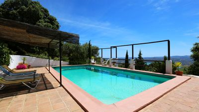 Photo for Characterful stylish Andalucian Cortijo - huge pool and panoramic lake/sea views