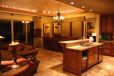 Great room. Wide open space for entertainment. Dining table and large kitchen.