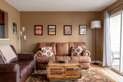 Spacious living room with pullout sofa that turns into a Twin bed.
