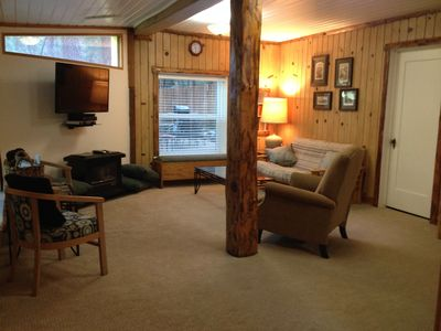 Step into the living room ; oil stove, flat screen tv and plenty of seating.