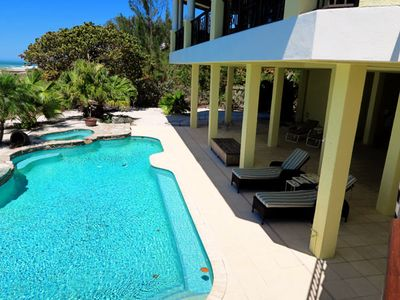 Pool with open and covered areas to lounge.  Pool bath too