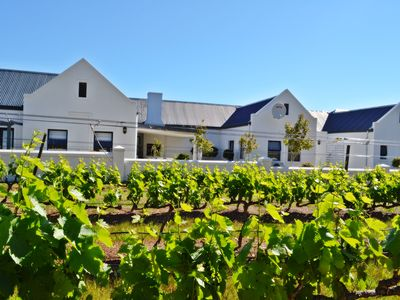 Photo for Luxury 4 bedroom home within a working cape winelands farm