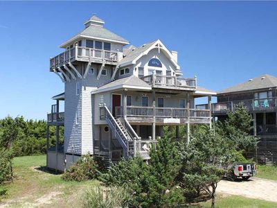 Photo for Views! Hot tub! Walk to beach, dining, grocery, shopping!