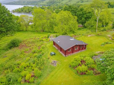 Photo for Log Cabin with private grounds and beach.  Fishing rights and amazing views.