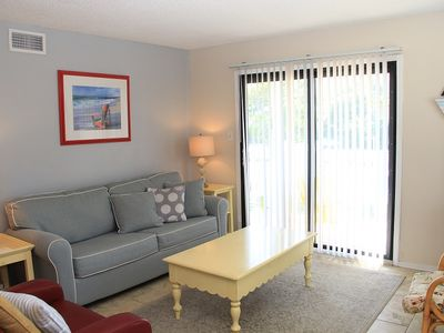 Photo for DEEP DISCOUNT PRICE FOR FALL & WINTER. RV311  Updated 2 bedroom 2 bath Large Balcony Across the Street from the Beach! Complex has Large outdoor Pool! Come and experience our sugar white sandy beaches for yourself.  QUOTE COMES WITH 1 PARKING PASS
