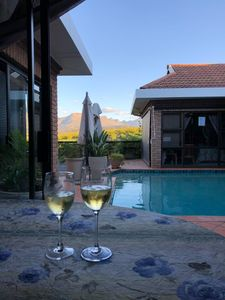 Relax at the pool overlooking the mountains and vineyards