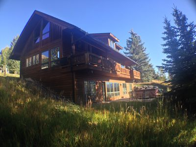 Back of the Newhard Chalet, showing deck and hot tub on patio