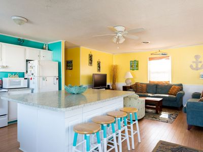 Photo for Bright & Beachy cottage - walk to the beach!
