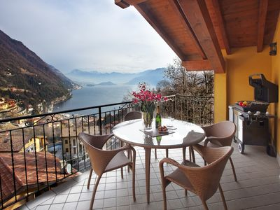 Photo for Penthouse apartment with two private balconies and 180° panoramic lake view.