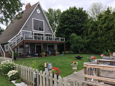 Deck, patio furniture, fire pit. Three levels of fun! Boat access to water level