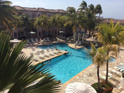 The Back Pool is surrounded by majestic palms providing plenty of natural shade.