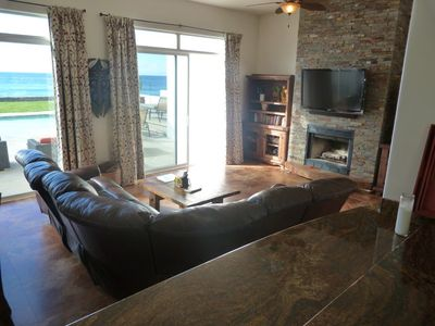 Eigth person leather reclining couch with flat screen DirecTV, fireplace.