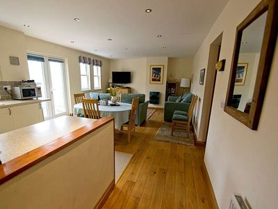 Photo for Cosy dog friendly 2 bed apartment with small garden and patio with seaviews!