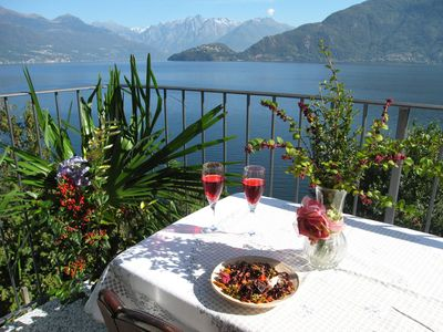 Photo for Riva di Pianello balcony apt. on lake (ground fl.)