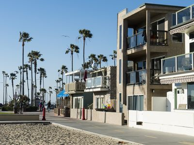 Photo for Oceanfront Beach house: steps away from beach, pier, and business district.