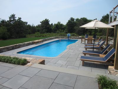 15x38 foot Heated Pool with chaises, tables & umbrellas