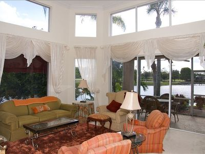living-room, sunny, high ceilings, additional tv inside armoire, screened lanai