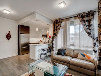 Photo for Bright, Comfortable, Entertainment district,10 minute walk to Calgary Stampede