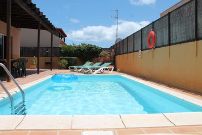 Private heated swimming pool in all day sun