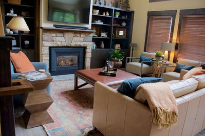 Comfortable living room with cozy fireplace and 55 inch TV