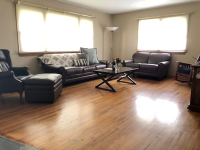 Family room provides 2 large chairs, couch and love seat