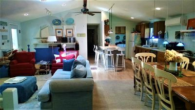 Photo for SCREEN PORCH. Spacious Living Area.  At Oak Street Beach. Sleeps 8-14 people